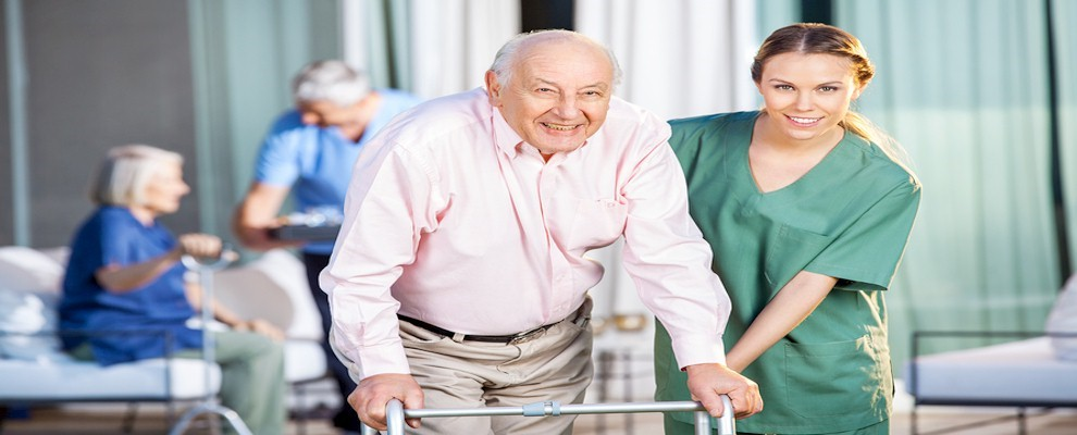 Nurse with patient in care home